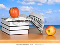 stock-photo-red-apple-on-open-book-56882443